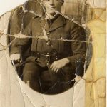 Scratched creased photograph of soldier before restoration